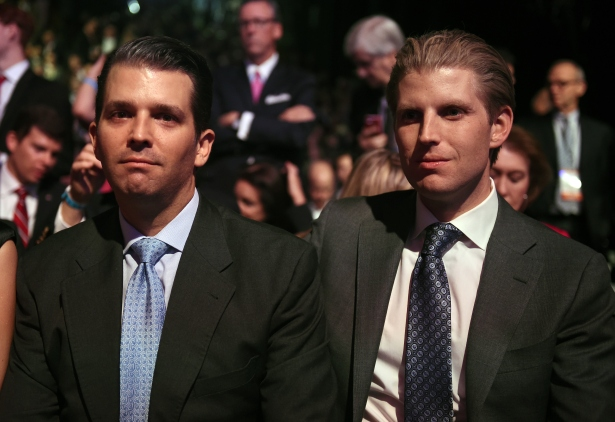 Donald Trumps son's Eric Trump (L), and Donald Trump Jr. wait for the start of the CNBC Republican Presidential Debate, October 28, 2015 at the Coors Event Center in Boulder, Colorado. (ROBYN BECK/AFP/Getty Images)