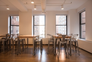Unlike the polished concrete of some of Compass' other floors, the fifth floor features dark hardwood (Photo: Emily Assiran/Commercial Observer).