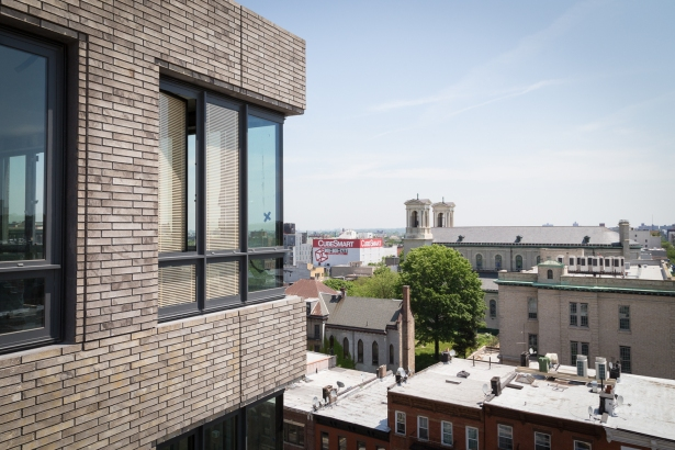 The brick on the exterior of 550 Vanderbilt Avenue is meant to mimic the color and texture of the neighboring church, Co-Cathedral of St. Joseph (Photo: Kaitlyn Flannagan for Commercial Observer).