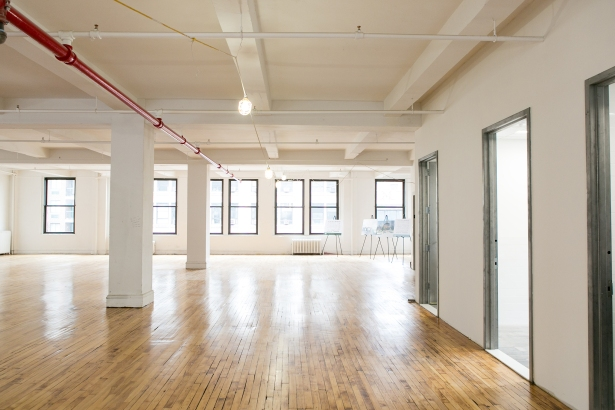 The landlord kept the original floors of the building to keep with the gritty look of Midtown South.