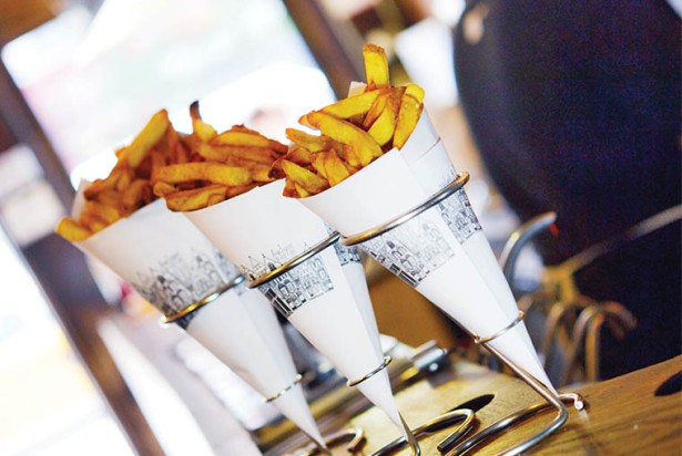 FRY DAZE: Pommes Frites, with its cone of Belgian-style fries, has had a slow go of it since reopening in May on MacDougal Street.